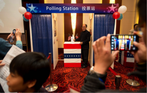 U.S. embassies have long hosted election watch parties to introduce foreign audiences to the American electoral process. In 2012, embassy guests in Beijing tried out a mock polling station. Ed Jones/AFP/Getty Images