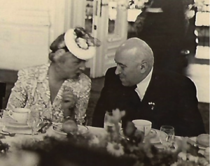 Aida Reid Schoenfeld, wife of U.S. Minister H.F. Arthur Schoenfeld, speaking with Deputy Prime Minister Matyas Rakosi at farewell dinner in Budapest May 1947