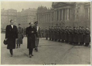 U.S. Minister H.F. Arthur Schoenfeld reviewing a Hungarian honor guard in Kossuth Square after presenting his credentials, January 26, 1946