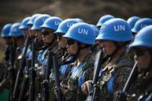 Line of UN peacekeeping troops in blue helmets